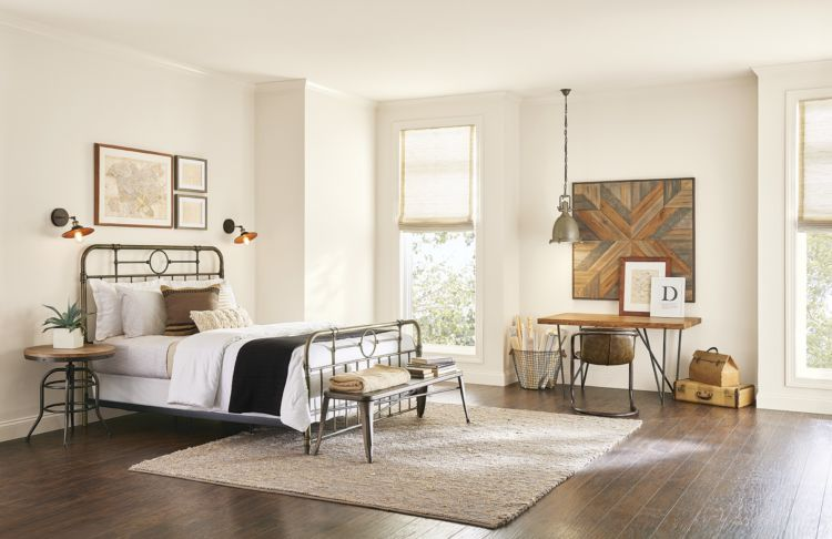 3 Ways to Use White Paint Colors - Bedroom painted in a warm shade of white.