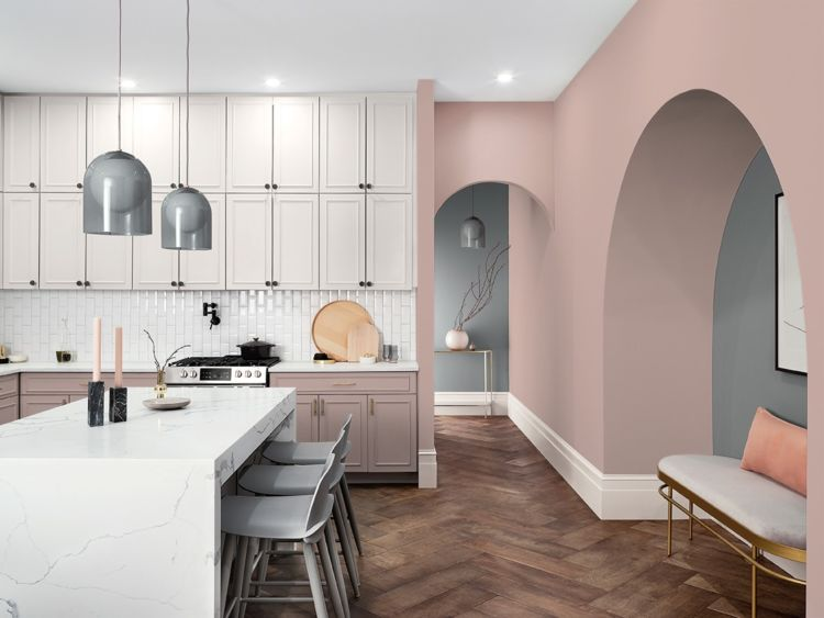 kitchen with island and pink patellae wall