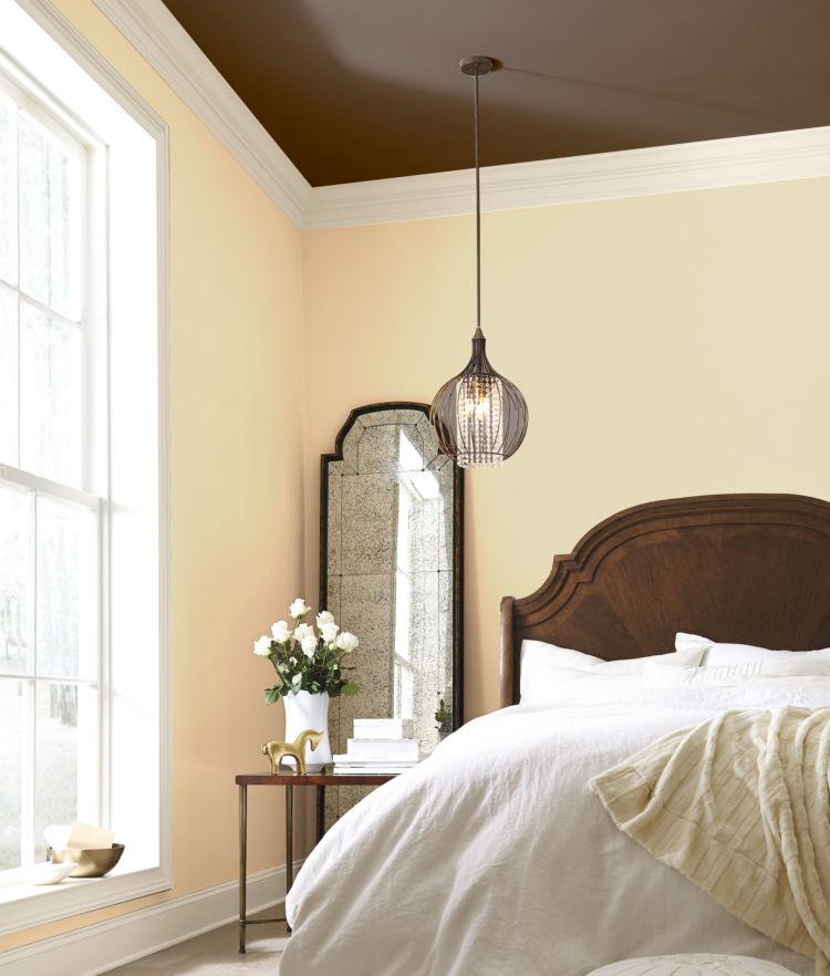 Bedroom, part of bed, mirror, creamy walls, window
