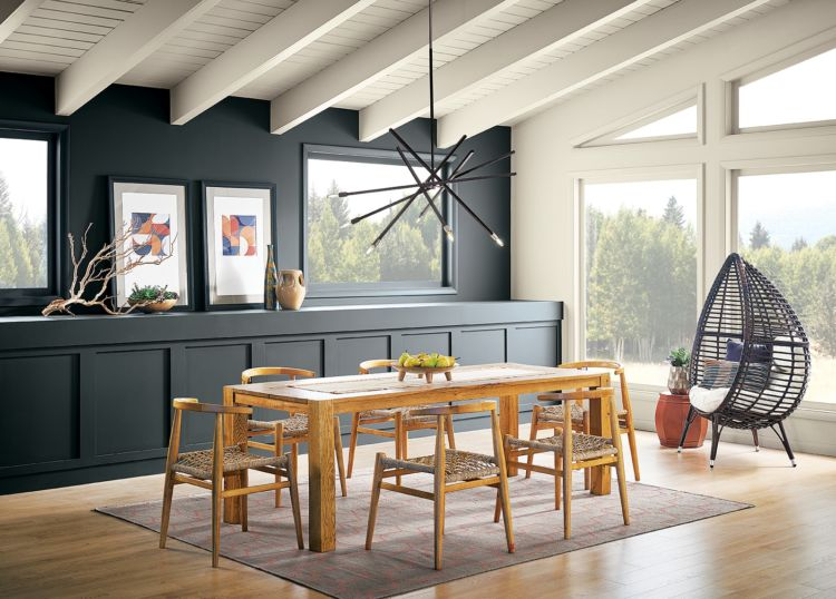 dining table, black and white walls, big windows