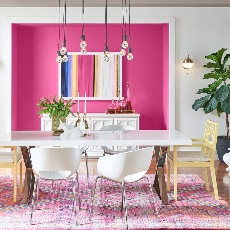 Dining room, bold pink wall, white table and chairs