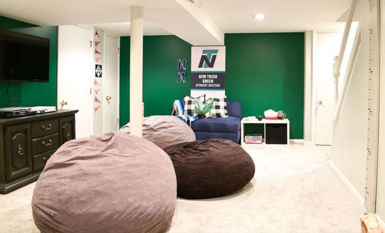 Basement, green walls, huge pillow-seats on the floor
