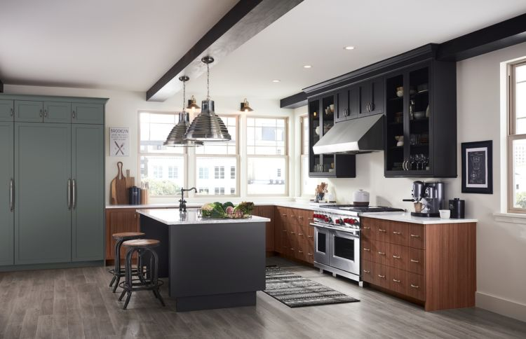 Dark grey Island and grey and brown counters in luxury kitchen
