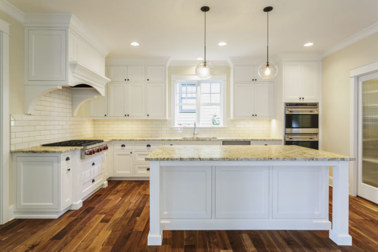 marble island and white counters in luxury kitchen