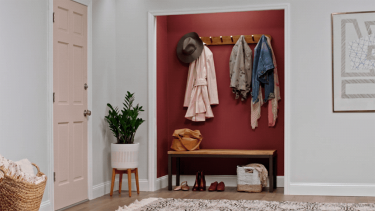 open closet with clothes by entry door