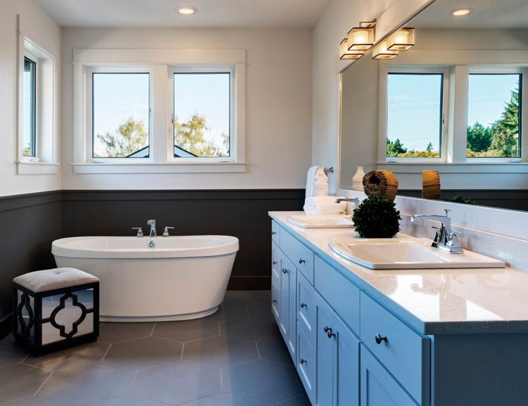 bathroom, white and dark gray walls, big mirror above two lavatories