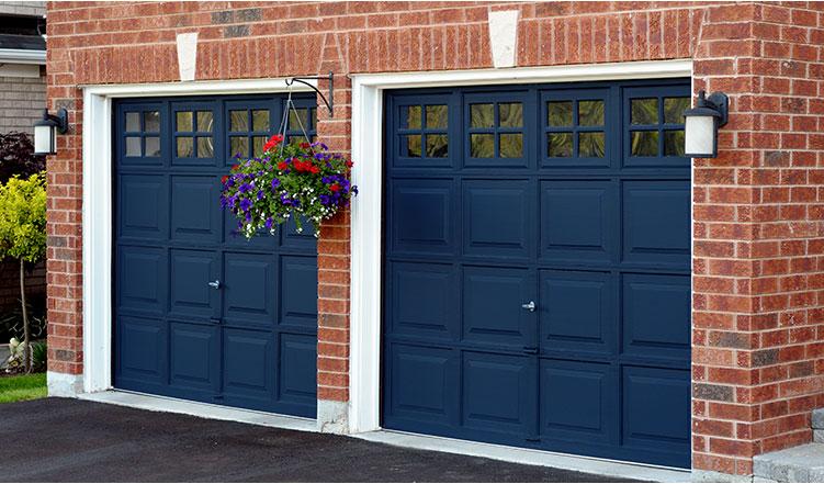 navy blue garage door, red brick walls