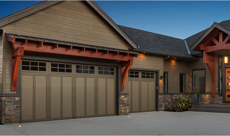 creamy house front, creamy garage doors, nighttime