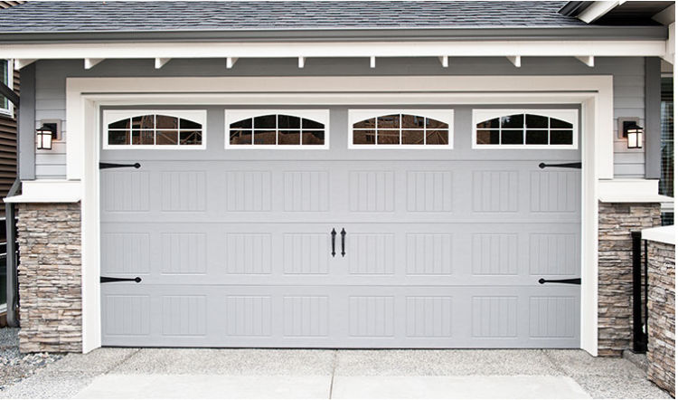 grey garage door, part of grey walls and rooftop