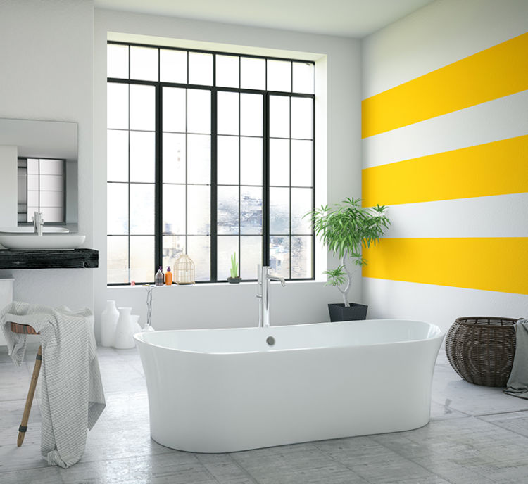 large bathroom with big window, white wall, the wall on the right have thick yellow stripes, large bathtub in the middle