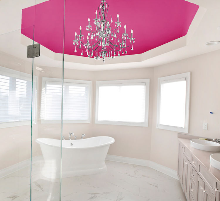 rounded bathroom, bathtub in the center, pink ceiling, pinkish white walls, chandelier