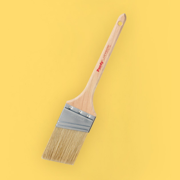 trim paint brush on yellow background