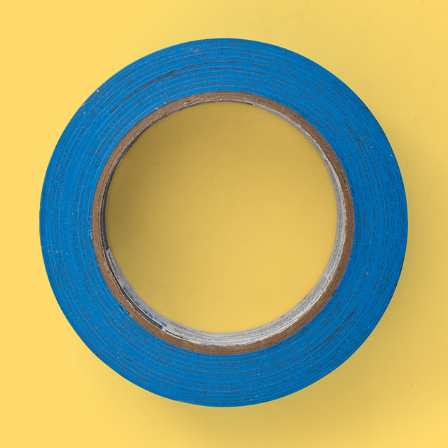 painter's blue tape on yellow background
