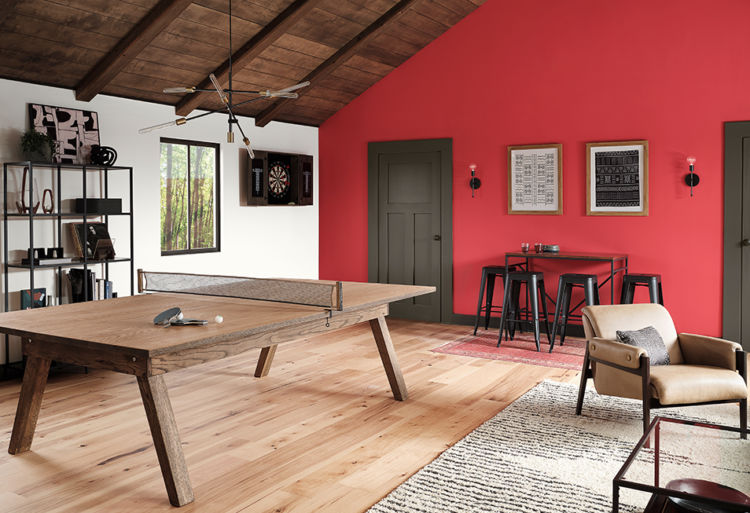 game room with wooden poin pong table and red walls