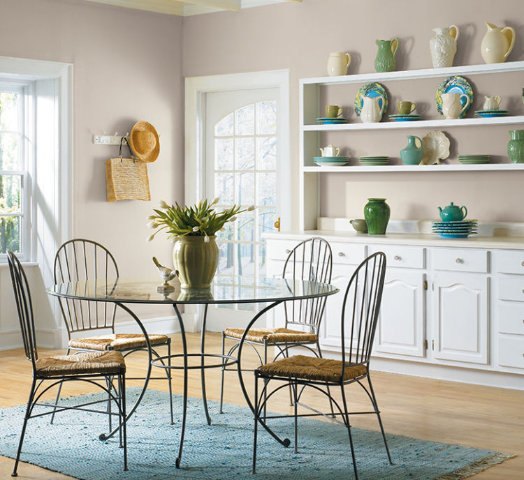 kitchen, metal rounded table with glass top and metal chairs, modern gray walls