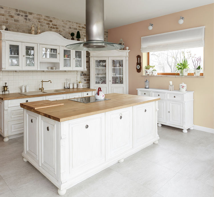 kitchen, white cabinets with glass, white island with wooden top, ivory walls