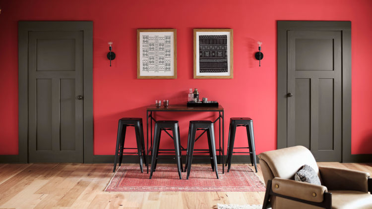 game room, red wall with 2 doors, one on left side one on the right