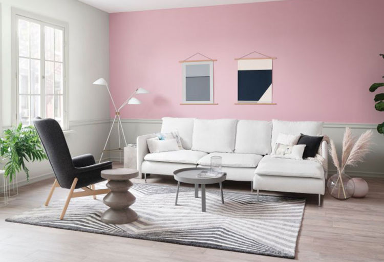 living room, pink wall behind and white with window on the left, white couch