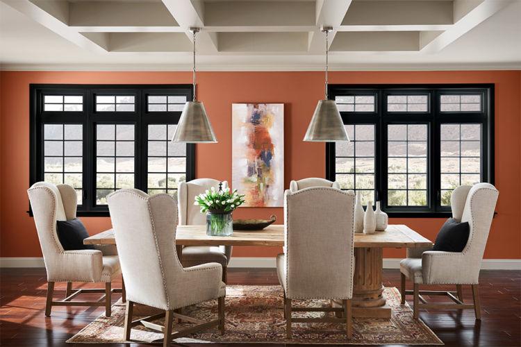 dining table, peach walls, black window frames