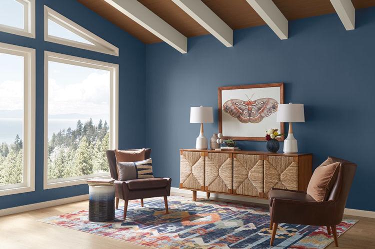 Living room, blue walls, big windows on the left side