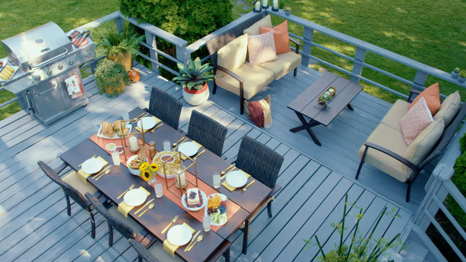 Wooden deck, table with chairs, grill