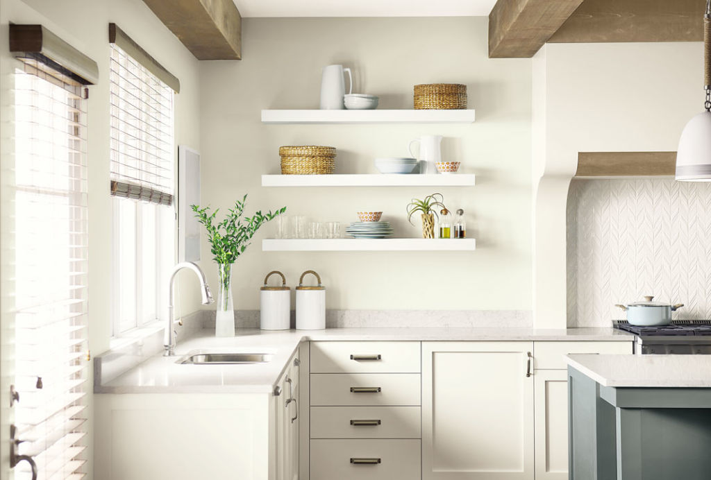 Kitchen corner, sink, coutertops, white walls and cabinets