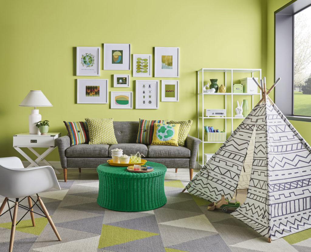 living room with green wall, toy Indian tent