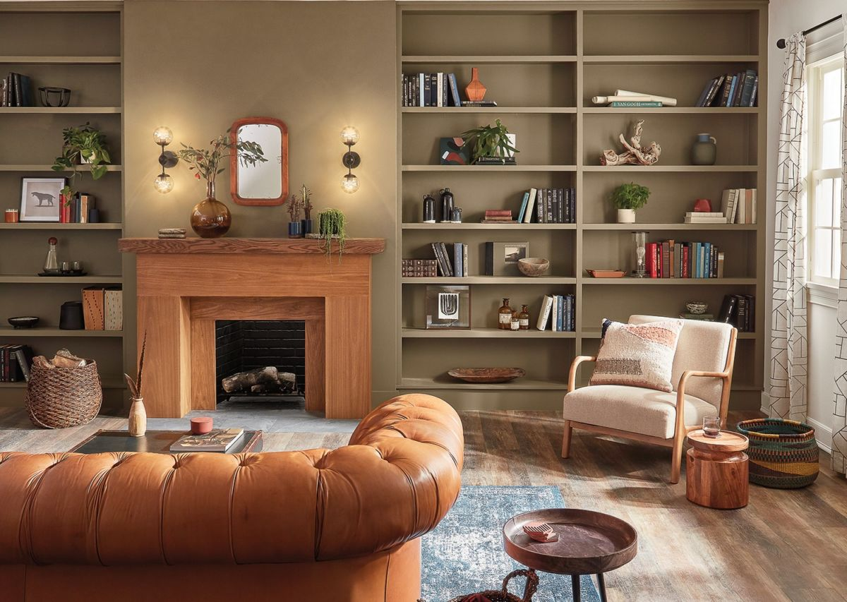 Living room, fireplace, brown leather sofa, bookshelves