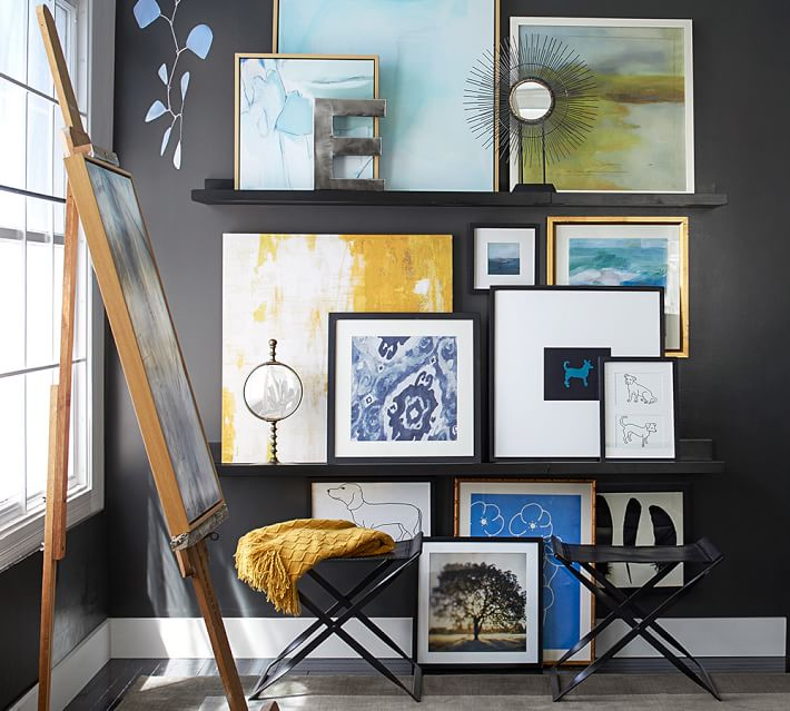 art studio room, pictures and frames on shelves, easel