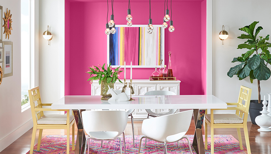 Dining room with pink and white walls