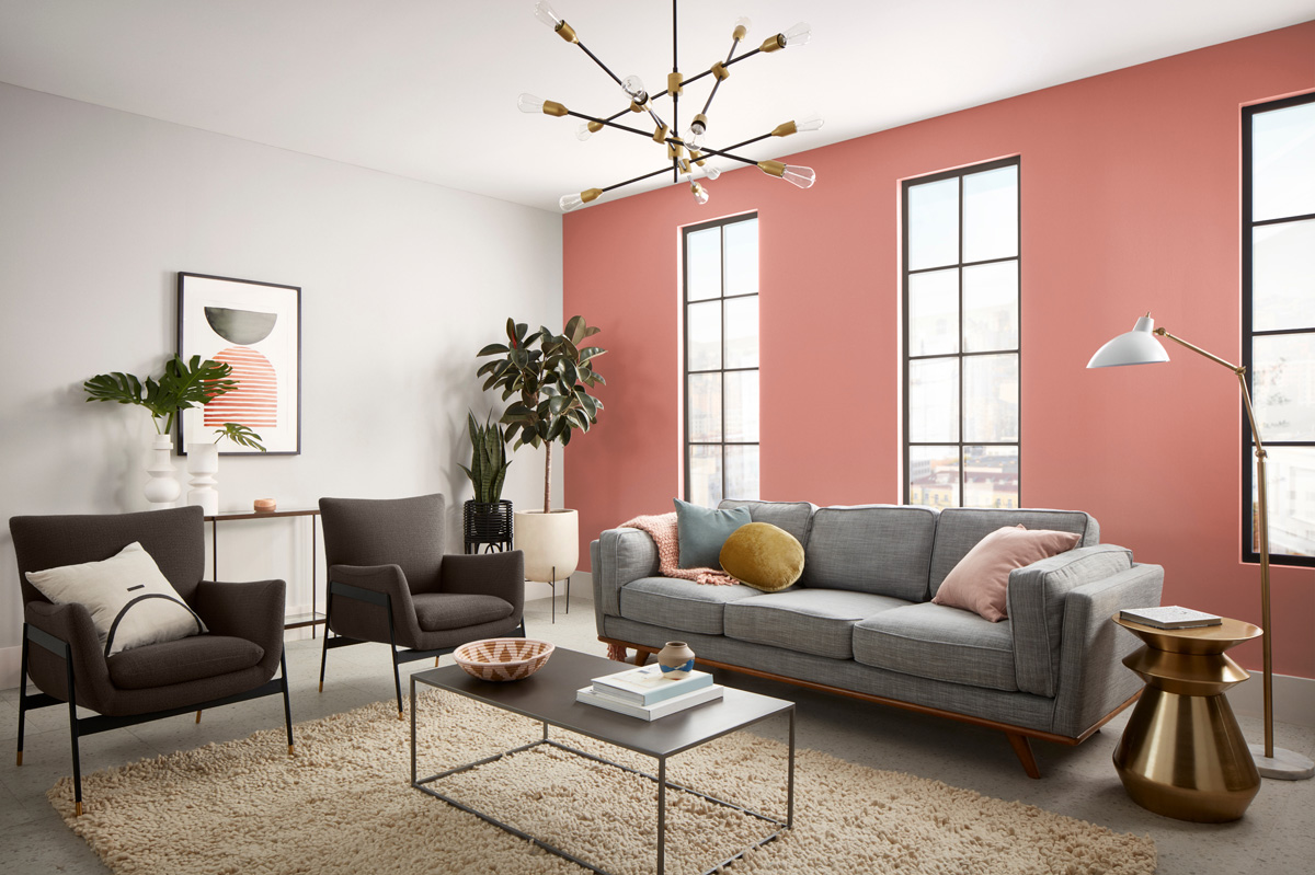 Living room, peach and white walls, tall windows, couch, small coffee table, rug