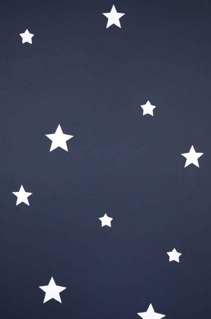 white start on dark blue wall