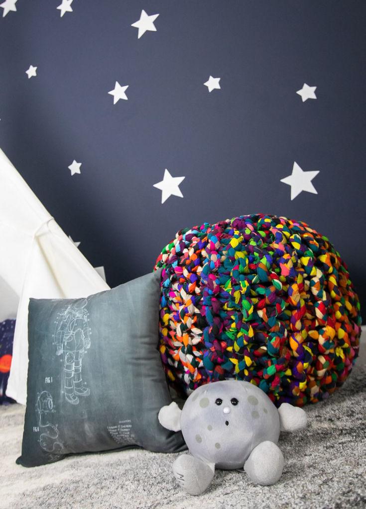 white stars on dark blue wall, pillows on the floor, kids' bedroom makeover