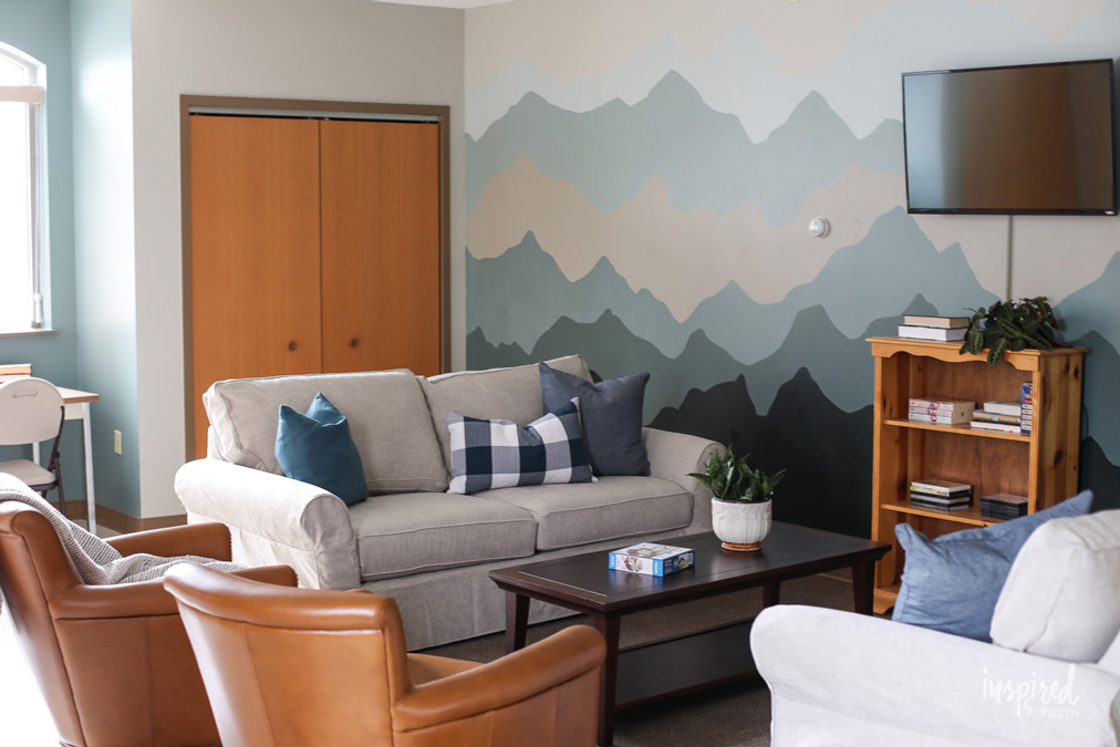 living room, mountains painted on the wall