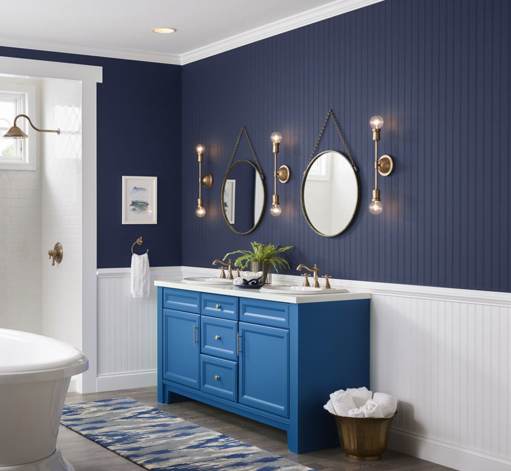 Bathroom, blue cabinet with 2 sinks, 2 mirrors, navy blue and white walls