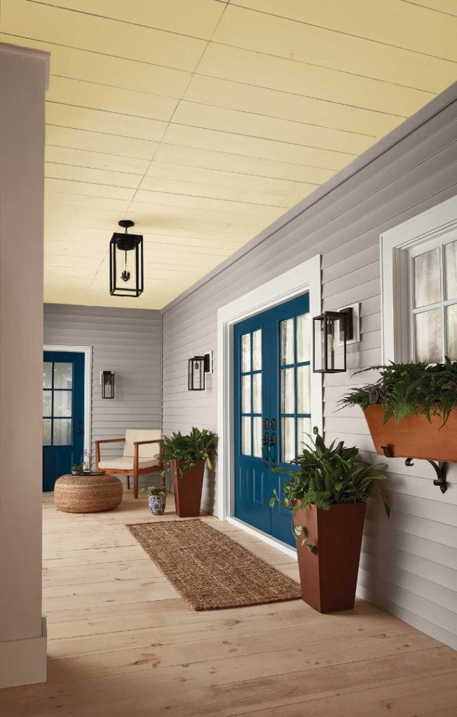 Front porch ceiling accented with yellow paint.