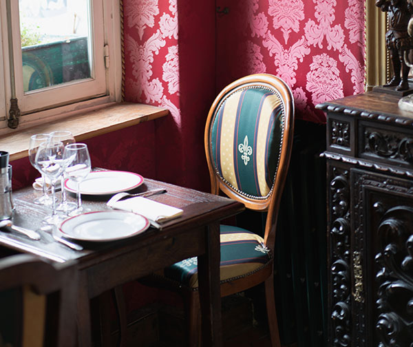 Victorian chair, table and wallpaper