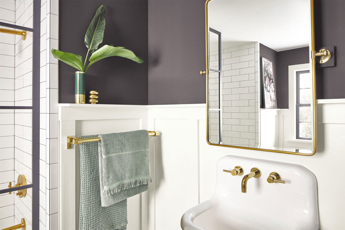 Closeup of bathroom sink with gold fixtures painted in Perle Noir SW 9154
