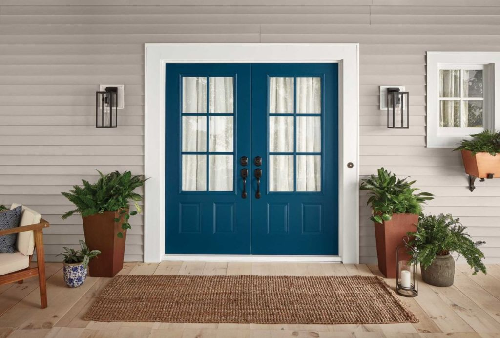 picture-perfect front porch with blue doors.