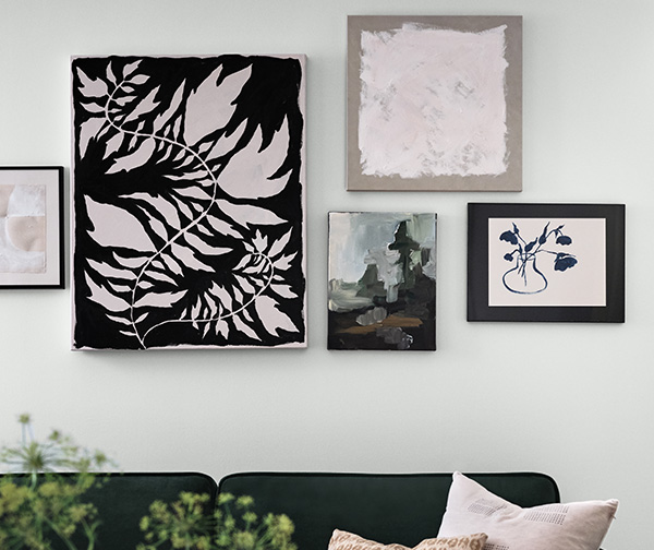 Geometrically arranged wall art featuring pink, black and brown colors hanging on a wall painted in Rock Candy SW 6231.