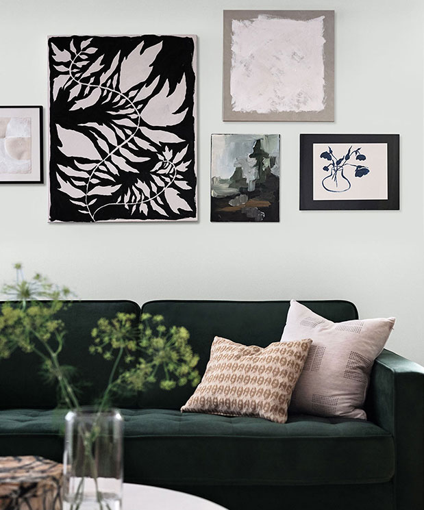 Gallery wall showing various styles of art on a wall painted Rock Candy SW 6231.