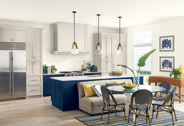 Kitchen Trends 2: Statement Designs. A blue and white tuxedo kitchen with blue for the island and gray for the upper cabinets