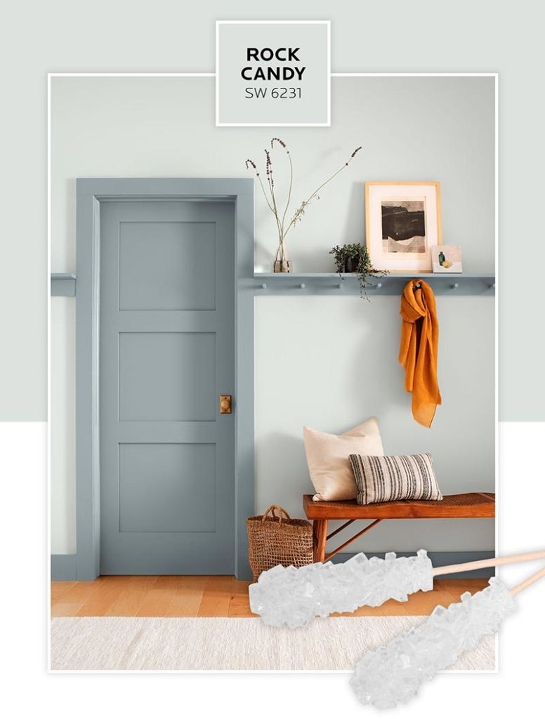 A hallway vignette with walls painted in Rock Candy.