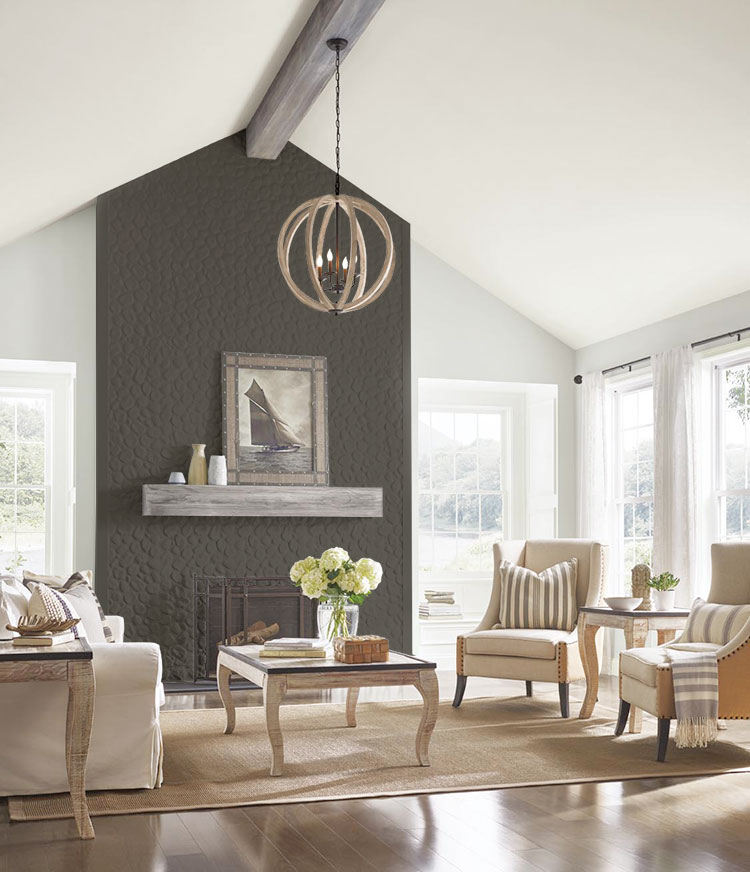 a traditional living room with lofted ceilings and a stone fireplace