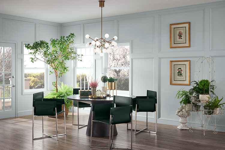 Biophilic design - An airy dining room with lots of natural light and wainscoting