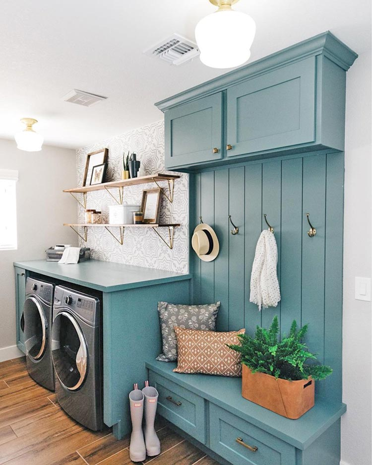A calming laundry room with built-ins painted in Studio Blue Green