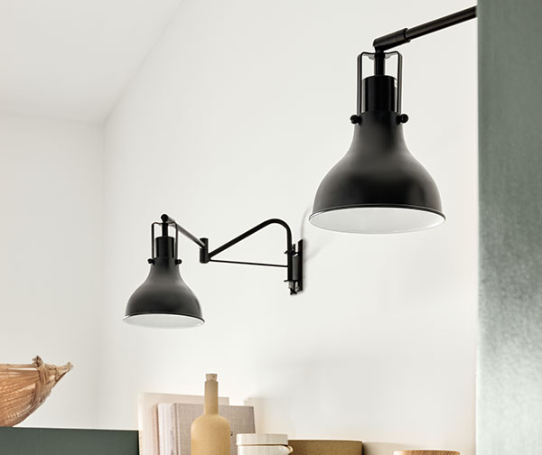 Black and white statement lighting above open kitchen shelves.