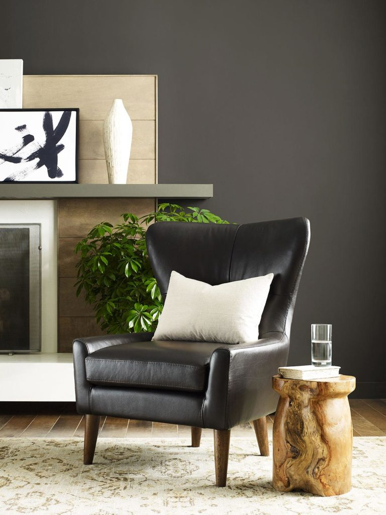 living room vignette with leather arm chair and natural materials