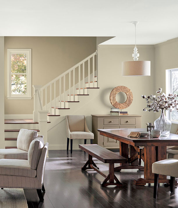 open floor plan featuring a living room and dining room decorated with neutral colors and natural materials