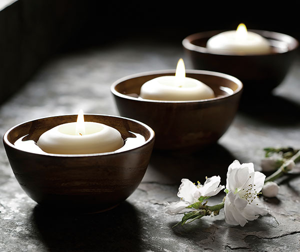 Tealights floating in bowls.